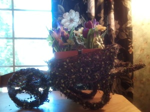 Wheelbarrow with artificial flowers